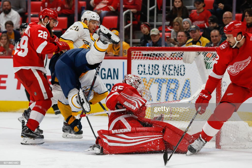 Nashville Predators forward Austin Watson (51) collides with Detroit Red Wings goalie Jimmy Howard (35) during the third period of a regular season NHL hockey game between the Nashville Predators and the Detroit Red Wings on February 20, 2018, at Little Caesars Arena in Detroit, Michigan. Nashville defeated Detroit 3-2.
