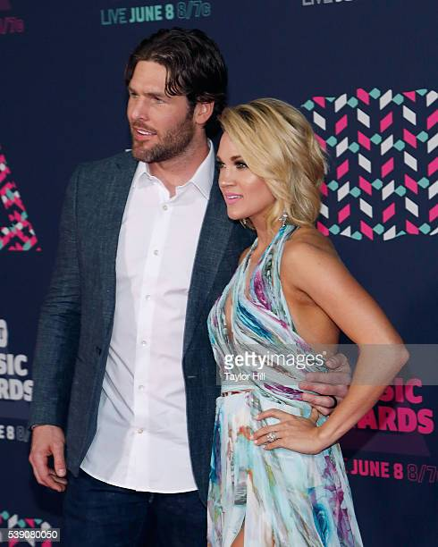 Nashville Predators forward Mike Fisher and Carrie Underwood attend the 2016 CMT Music awards at the Bridgestone Arena on June 8 2016 in Nashville...