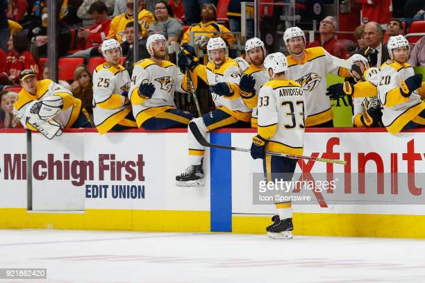 Nashville Predators forward Viktor Arvidsson of Sweden receives congratulations from his teammates on the bench after scoring a goal during the third...