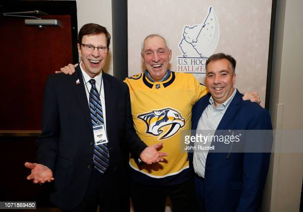 Nashville Predators General Manager David Poile has a laugh with fellow U.S. Hockey Hall of Fame Class of 2018 inductee Paul Stewart and Predators...