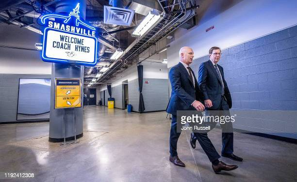 Nashville Predators general manager David Poile walks with John Hynes prior to his first game as the new head coach of the Nashville Predators...