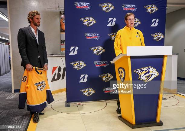 Nashville Predators GM David Poile and team captain Roman Josi prepare to announce goalie Yaroslav Askarov as the 11th pick overall during Round One...