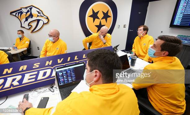 Nashville Predators GM David Poile and team personnel watch as Winnipeg pick before them in Round One of the 2020 NHL Draft on October 6, 2020 at...