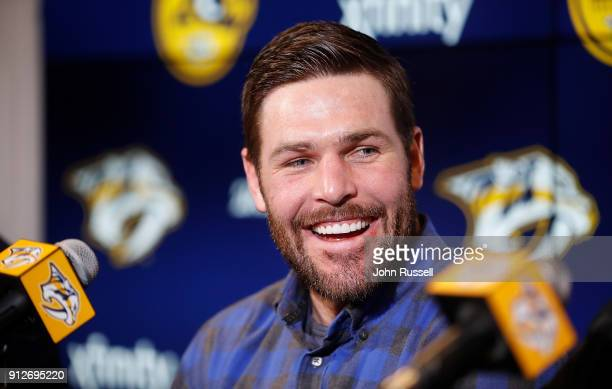 Nashville Predators GM David Poile announces Mike Fisher's return to play for the Predators as head coach Peter Laviolette looks on during a press...