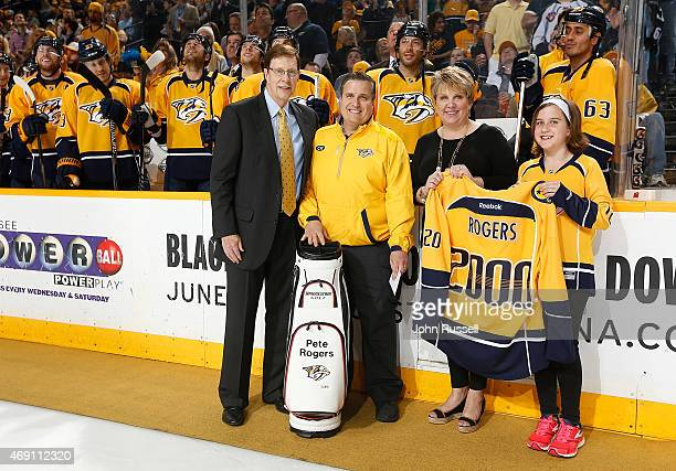 Nashville Predators GM David Poile recognizes equipment manager Pete Rogers for his 2000th game alongside him are his wife Judy and daughter Lexi...