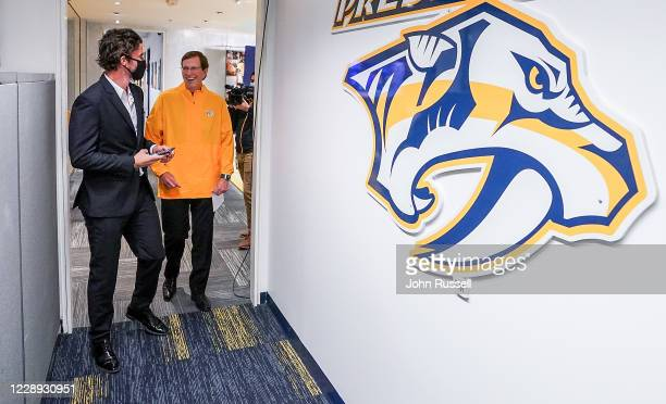 Nashville Predators GM David Poile shares a laugh with team captain Roman Josi after announcing goalie Yaroslav Askarov as the 11th pick overall...