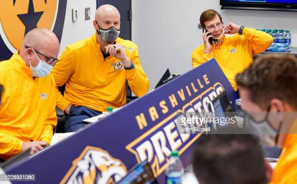 Nashville Predators GM David Poile talks with Director of Player Personnel Jeff Kealty and Chief Amateur Scout Tom Nolan as they prepare for the 11th...