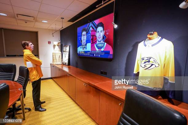 Nashville Predators GM David Poile watches NHL Draft commentary on goalie Yaroslav Askarov after picking him 11th overall during Round One of the...