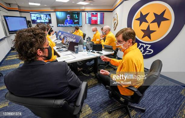 Nashville Predators GM David Poile with team captain Roman Josi as they prepare to make the 11th overall selection during Round One of the 2020 NHL...