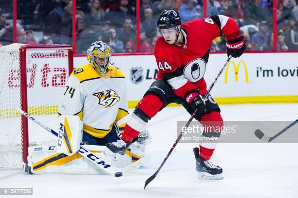 Nashville Predators Goalie Juuse Saros prepares to make a save on a tipped shot by Ottawa Senators Center JeanGabriel Pageau during third period...