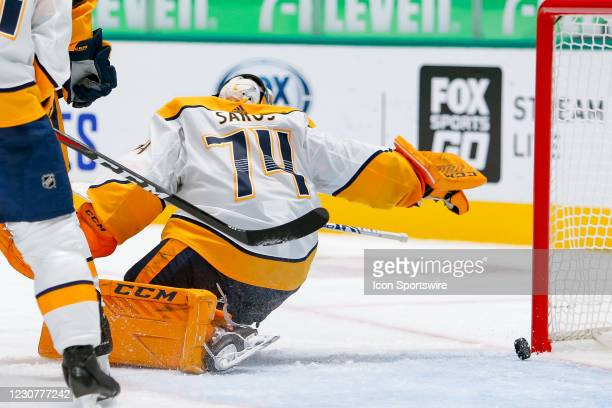 Nashville Predators Goalie Juuse Saros scramble for a puck but it crosses the line for a goal during the game between the Nashville Predators and...