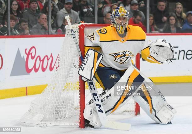 Nashville Predators Goalie Pekka Rinne follows the play during a NHL game between the Minnesota Wild and Nashville Predators on December 29 2017 at...