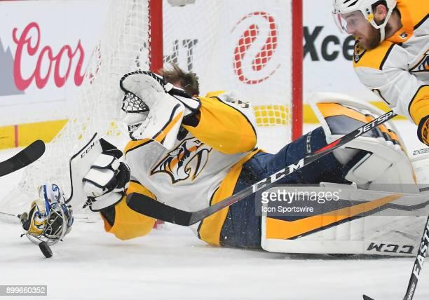 Nashville Predators Goalie Pekka Rinne looses his mask on this play during a NHL game between the Minnesota Wild and Nashville Predators on December...