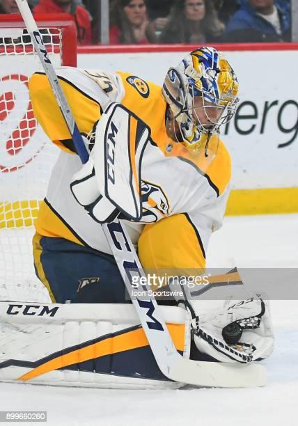 Nashville Predators Goalie Pekka Rinne makes a glove save during a NHL game between the Minnesota Wild and Nashville Predators on December 29 2017 at...