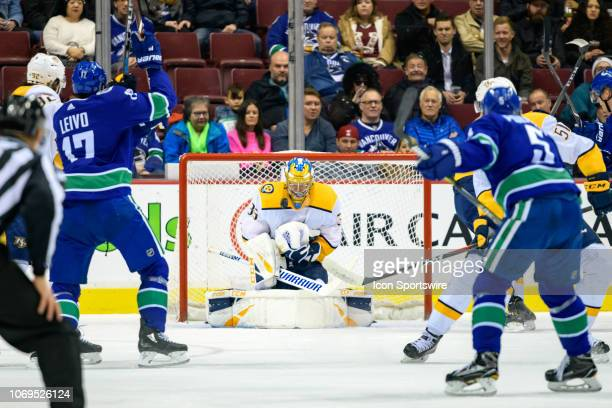 Nashville Predators Goalie Pekka Rinne makes a save during their NHL game against the Vancouver Canucks at Rogers Arena on December 6, 2018 in...