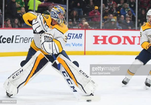 Nashville Predators Goalie Pekka Rinne plays the puck during a NHL game between the Minnesota Wild and Nashville Predators on December 29 2017 at...