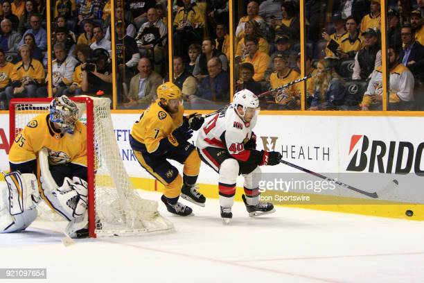 Nashville Predators goalie Pekka Rinne protects the post as Nashville Predators defenseman Yannick Weber defends against Ottawa Senators right wing...