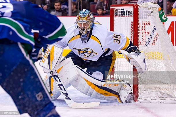 Nashville Predators Goalie Pekka Rinne tracks the play against the Vancouver Canucks during their NHL game at Rogers Arena on January 17 2017 in...