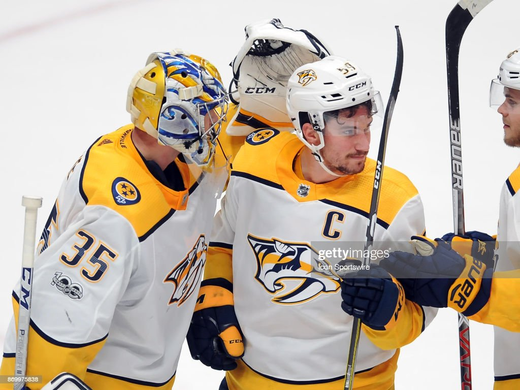 Nashville Predators goalie Pekka Rinne (35) with captain Roman Jose (59) after the Predators defeated the Anaheim Ducks 5 to 3 in a game played on November 3, 2017 at the Honda Center in Anaheim, CA.