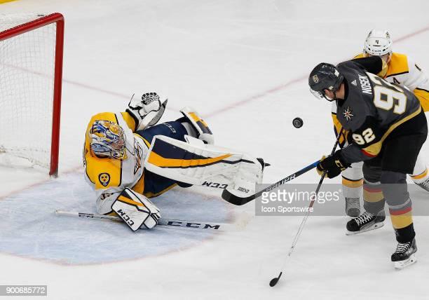 Nashville Predators goaltender Pekka Rinne blocks the puck during the third period of a regular season game between the Nashville Predators and the...