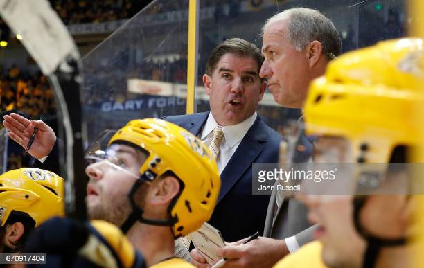 Nashville Predators head coach Peter Laviolette and assist coach Kevin McCarthy coach against the Chicago Blackhawks in Game Four of the Western...