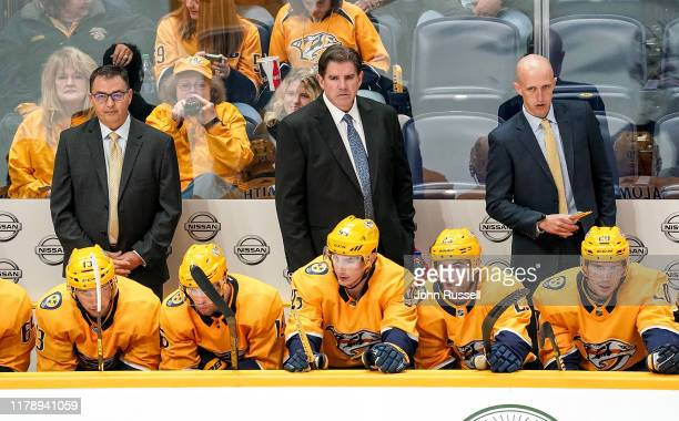Nashville Predators head coach Peter Laviolette and assistants Dan Lambert and Dan Muse watch the action against the Chicago Blackhawks at...