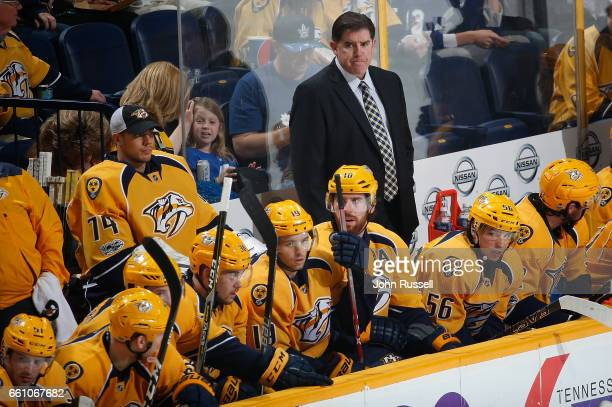 Nashville Predators head coach Peter Laviolette coaches in his 1000th career NHL game on March 30 2017 against the Toronto Maple Leafs at Bridgestone...