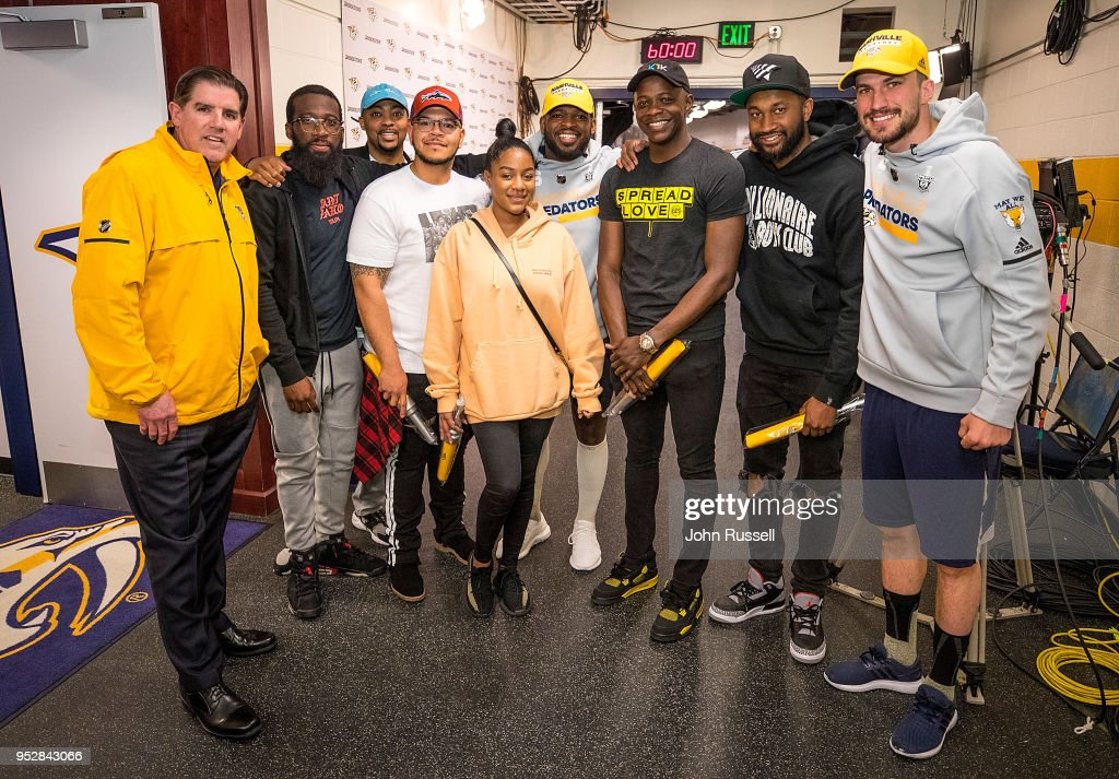 Nashville Predators head coach Peter Laviolette, Roman Josi #59 and P.K. Subban #76 pose with Waffle House shooting hero James Shaw Jr., third from left, and his friends prior to Game Two of the Western Conference Second Round against the Winnipeg Jets during the 2018 NHL Stanley Cup Playoffs at Bridgestone Arena on April 29, 2018 in Nashville, Tennessee.