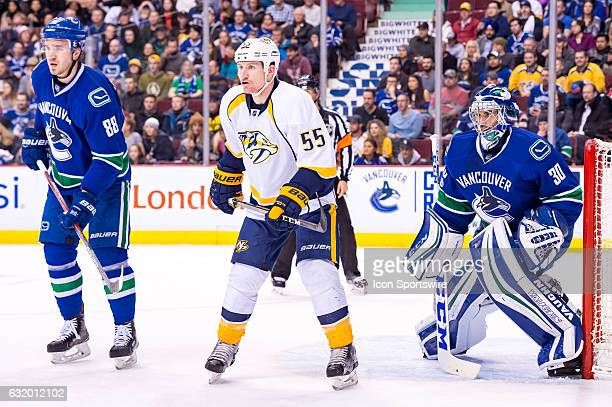 Nashville Predators Left Wing Cody McLeod screens Goalie Ryan Miller as Vancouver Canucks Defenceman Nikita Tryamkin defends during their NHL game at...