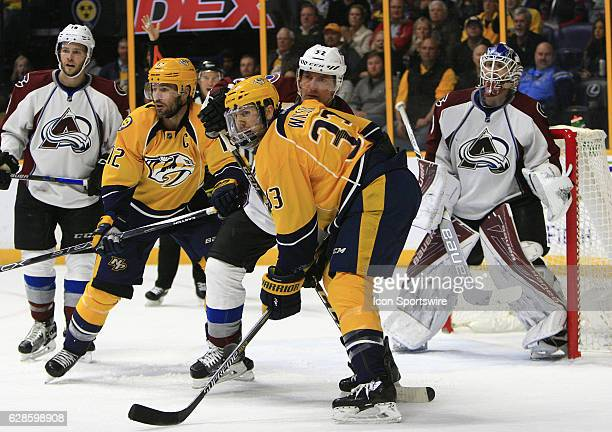 Nashville Predators left wing Colin Wilson and Nashville Predators center Mike Fisher battle for position with Colorado Avalanche defenseman Francois...