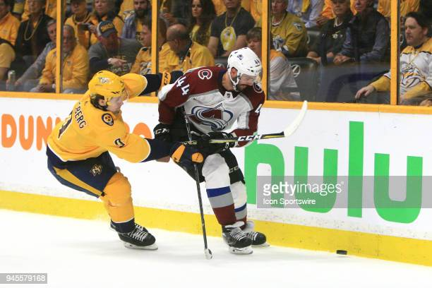 Nashville Predators left wing Filip Forsberg and Colorado Avalanche defenseman Mark Barberio battle for the puck during Game One of Round One of the...
