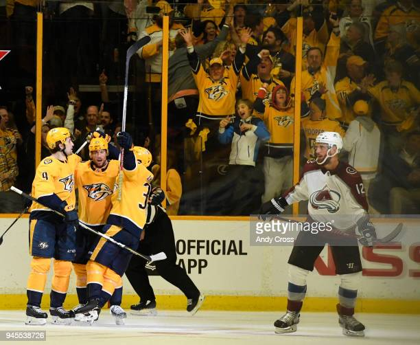 Nashville Predators left wing Filip Forsberg and Nashville Predators left wing Viktor Arvidsson celebrate with teammate Nashville Predators right...
