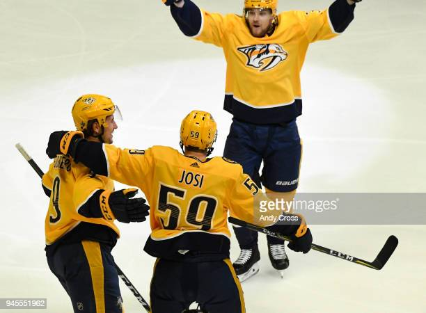 Nashville Predators left wing Filip Forsberg celebrates his first goal against the Colorado Avalanche in the third period with teammates Nashville...