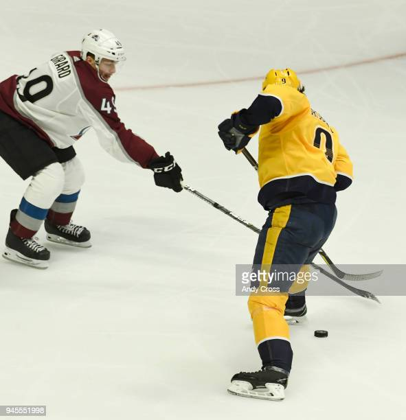 Nashville Predators left wing Filip Forsberg dribbles the puck between his legs and around Colorado Avalanche defenseman Samuel Girard and eventually...