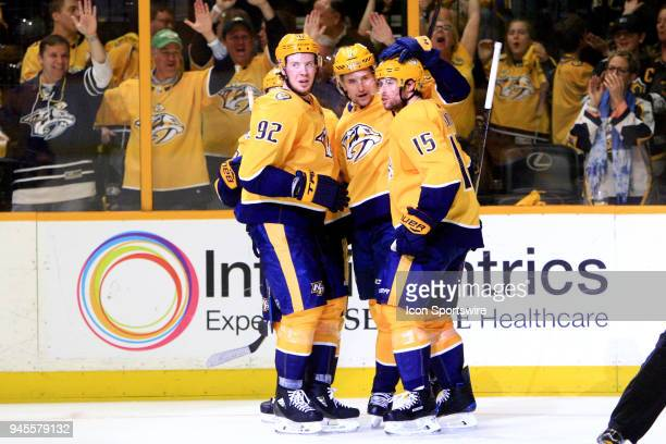 Nashville Predators left wing Filip Forsberg right wing Viktor Arvidsson and center Ryan Johansen congratulate right wing Craig Smith following his...