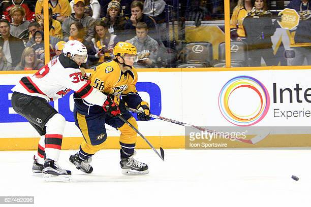 Nashville Predators left wing Kevin Fiala shields the puck from New Jersey Devils center Vernon Fiddler during the NHL game between the Nashville...
