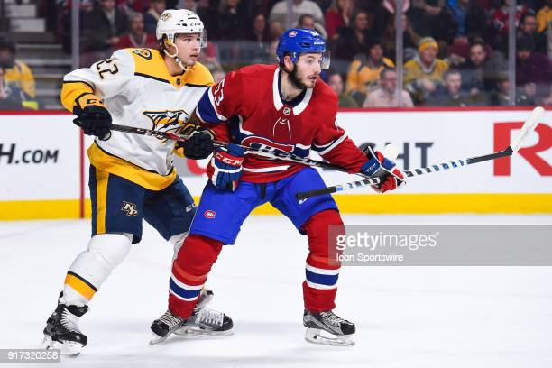 Nashville Predators Left Wing Kevin Fiala tries to push Montreal Canadiens Defenceman Victor Mete away during the Nashville Predators versus the...