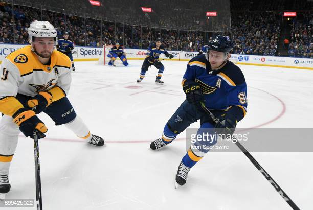 Nashville Predators leftwing Filip Forsburg and St Louis Blues right wing Vladimir Tarasenko compete for a loose puck during a NHL game between the...