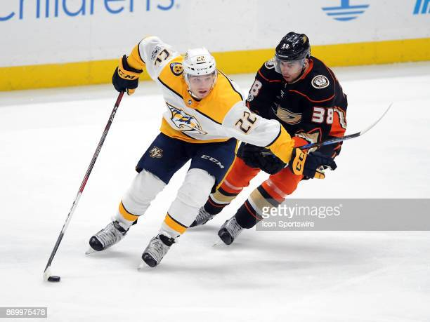 Nashville Predators leftwing Kevin Fail skates with the puck while Anaheim Ducks center Derek Grant gives chase during the third period of a game...