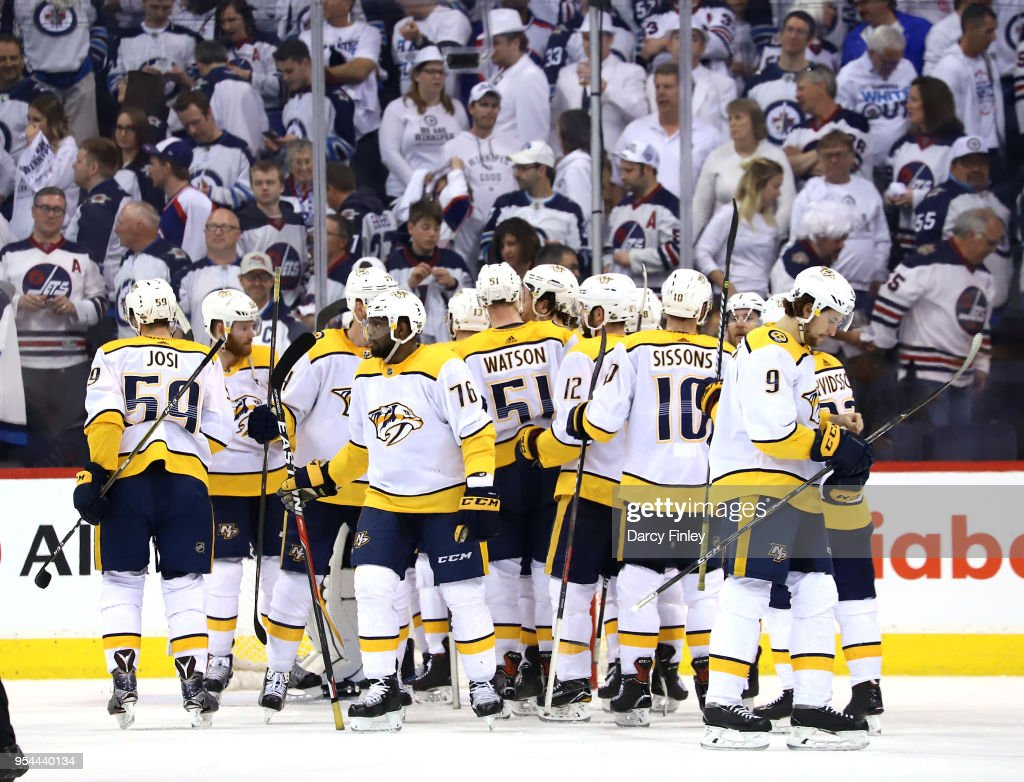 Nashville Predators players celebrate following a 2-1 victory over the Winnipeg Jets in Game Four of the Western Conference Second Round during the 2018 NHL Stanley Cup Playoffs at the Bell MTS Place on May 3, 2018 in Winnipeg, Manitoba, Canada. The series is tied 2-2.