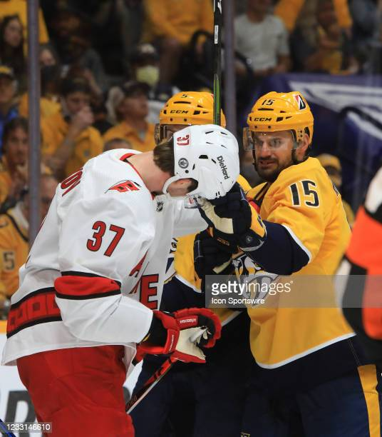 Nashville Predators right wing Brad Richardson and Carolina Hurricanes left wing Andrei Svechnikov wrestle after the whistle during Game 6 of the...