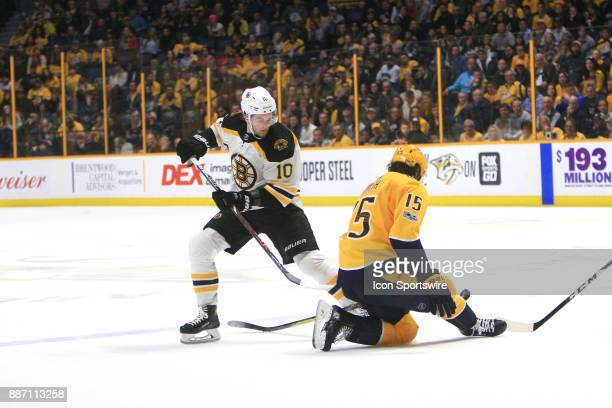 Nashville Predators right wing Craig Smith deflects the shot of Boston Bruins right wing Anders Bjork during the NHL game between the Nashville...