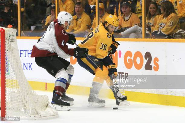 Nashville Predators right wing Ryan Hartman shields the puck from Colorado Avalanche defenseman Tyson Barrie during Game Two of Round One of the...