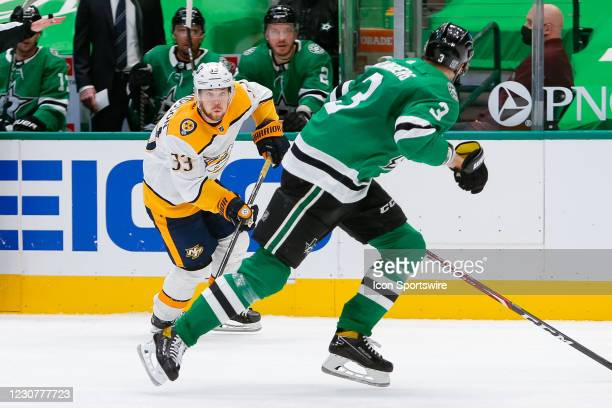 Nashville Predators Right Wing Viktor Arvidsson attacks the zone with Dallas Stars Defenceman John Klingberg racing back to defend during the game...