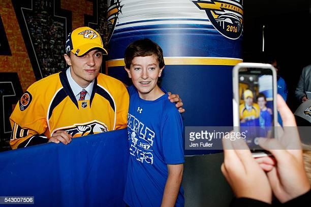 Nashville Predators Samuel Girard poses with a fan during the 2016 NHL Draft on June 25 2016 in Buffalo New York