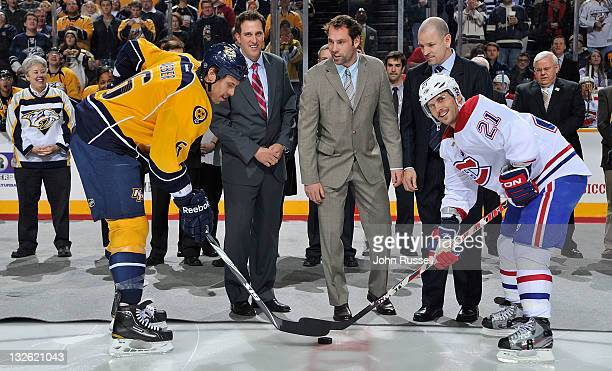 Nashville Predators Shea Weber and Brian Gionta of the Montreal Canadiens with the ceremonial faceoff with Predators alumni Tom Fitzgerald and Mike...