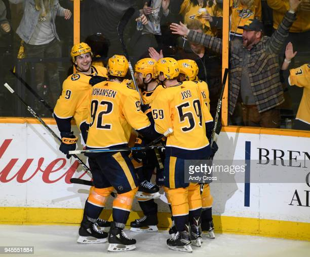 Nashville Predators teammates swarm Nashville Predators left wing Filip Forsbergleft after Forsberg scored against the Colorado Avalanche in the...