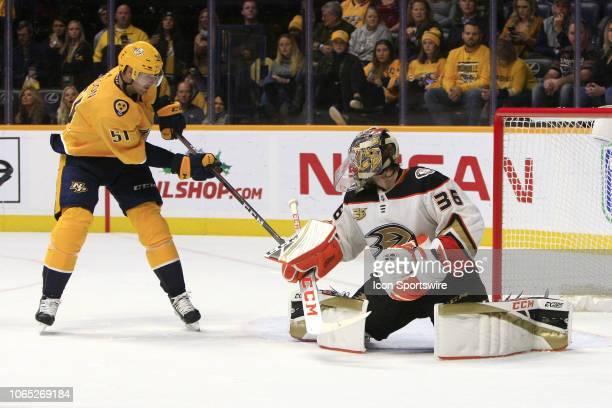Nashville Predators winger Austin Watson scores on Anaheim Ducks goalie John Gibson during the NHL game between the Nashville Predators and Anaheim...