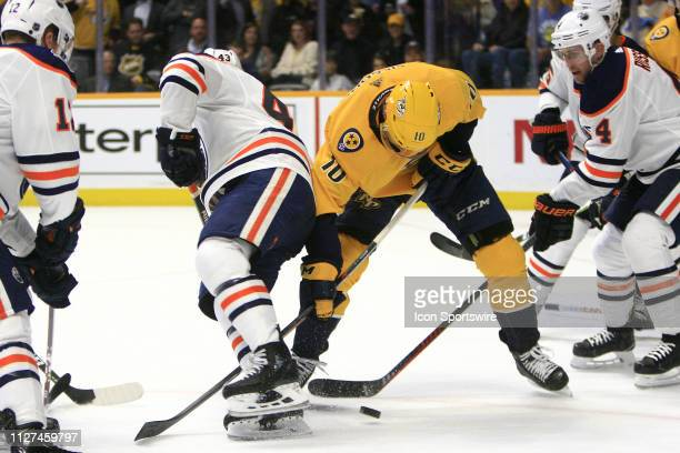 Nashville Predators winger Colton Sissons and Edmonton Oilers right wing Josh Currie battle for the puck during the NHL game between the Nashville...
