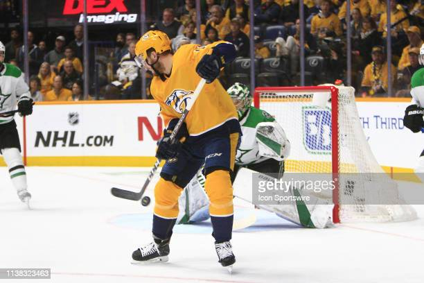 Nashville Predators winger Colton Sissons deflects the puck in front of Dallas Stars goalie Ben Bishop during Game Five of Round One of the Stanley...